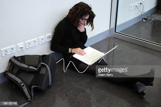 A participant uses a laptop on the first day of the 28th Chaos Communication Congress Behind Enemy Lines computer hacker conference on December 27...