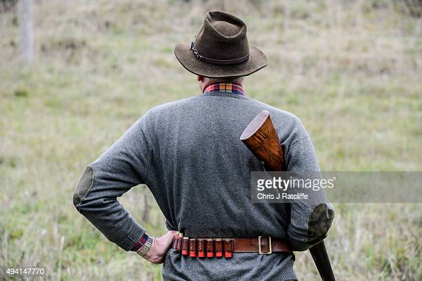 A participant waits for his shot on a pheasant and partridge shoot on October 23 2015 in Oxfordshire England The UK pheasant shooting season begins...
