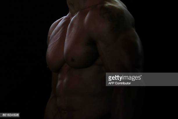 A participant waits for his turn to perform at the fitness and bodybuilding Arnold Classic Europe event in L'Hospitalet del Llobregat on September 22...