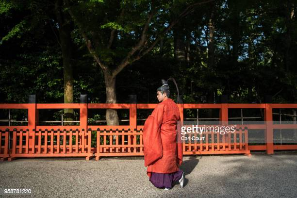 A participant waits in the grounds of Kamigamo shrine during the Aoi Festival on May 15 2018 in Kyoto Japan Aoi Festival is one of the three main...