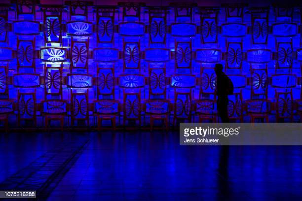Participant walks along an art installation on the first day of the 35C3 Chaos Communication Congress on December 27, 2018 in Leipzig, Germany. The...