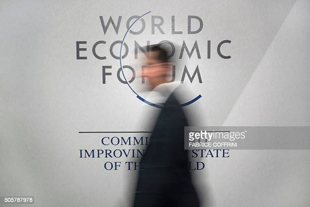 A participant walks past a logo during the World Economic Forum annual meeting in Davos on January 20 2016 A string of jihadist attacks and rising...