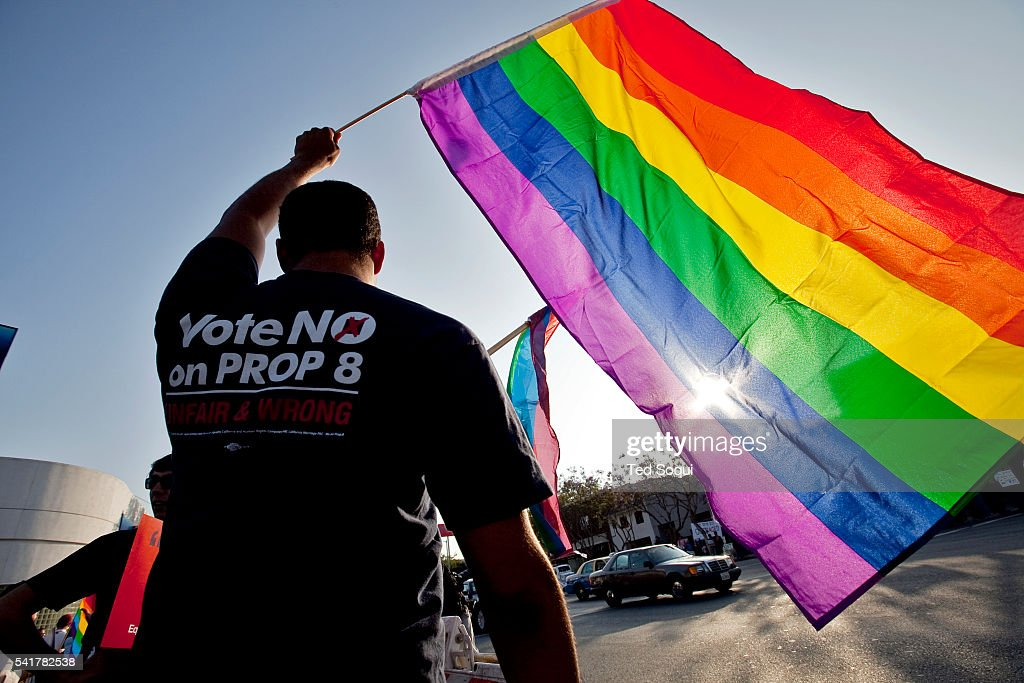 A Participant Waves A Rainbow Flag Symbol Of The Gay Rights News