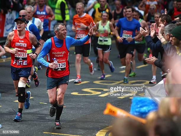 A participant waves to the fans during the 2016 Virgin Money London Marathon on April 24 2016 in London England