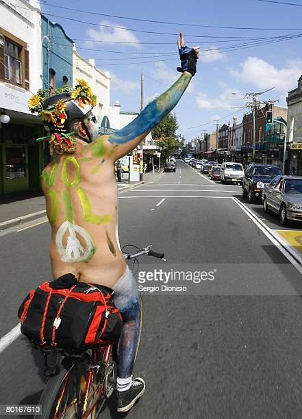 A participant waves to traffic as he takes part in the World Naked Bike Ride on March 8 2008 in Sydney Australia Around 30 protesters met in a secret...