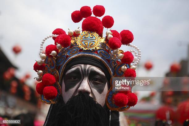 Participant wear a chinese traditioal costume and perform the Lion dance during Grebeg Sudiro a Javanese interpretation of Chinese Lunar New Year...
