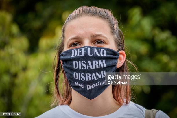 Participant wearing a Defund The Police face mask at the protest. Brooklynites gathered at Maria Hernandez Park in Bushwick to demand justice for...