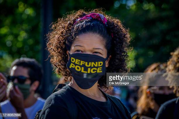 A participant wearing a face mask with the words Defund Police in it Thousands of protesters gathered at Mc Carren Park in Brooklyn for a massive...