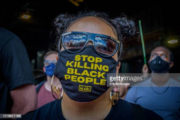 A participant wearing a face mask with the words Stop Killing Black People in it Hundreds of Brooklynites joined Democratic candidate for US House...