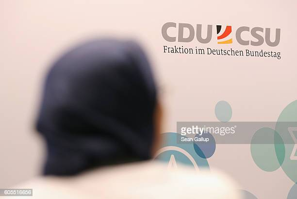 A participant wearing a headscarf arrives for a conference of the International Panel of Parliamentarians for Freedom of Religion or Belief at the...