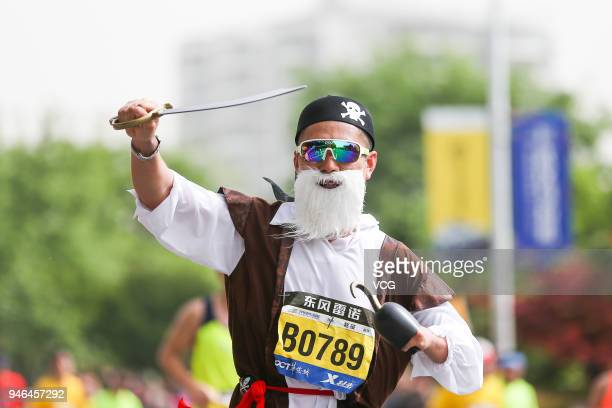 A participant wearing costume competes during the 2018 Dongfeng Renault Wuhan Marathon on April 15 2018 in Wuhan Hubei Province of China