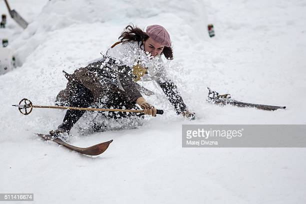 A participant wearing historical ski attire falls after jumping on vintage skis during a traditional ski race on February 20 2016 in Smrzovka Czech...