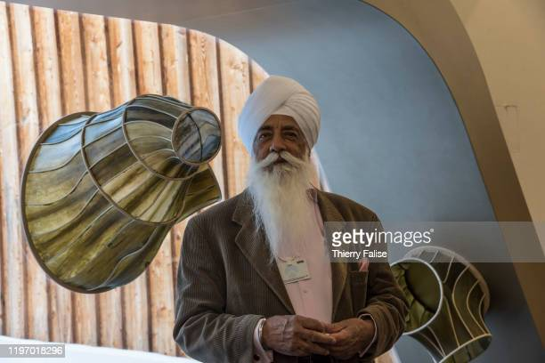 A participant wearing the sikh turban and beard stands in front of a part of a pavilion made of kelp and rattan made by designer Julia Lohmann's...
