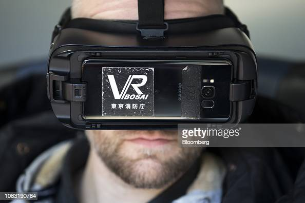 A participant wearing VR glasses takes part in an earthquake