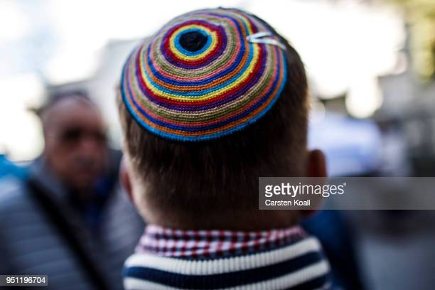 A participant wears a kippah during a wear a kippah gathering to protest against antiSemitism in front of the Jewish Community House on April 25 2018...