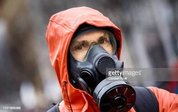 Participant wears a mask during an anti-lockdown protest march on the first anniversary of their Berlin demonstrations during the coronavirus...