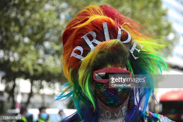 Participant wears a rainbow -mask in the annual Christopher Street Day parade on July 24, 2021 in Berlin, Germany. The Christopher Street Day parade...