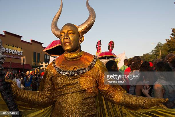 Participant wears costume with horn during the West Indian Day Parade. Thousands of revelers took to the streets of Crown Heights beginning around...
