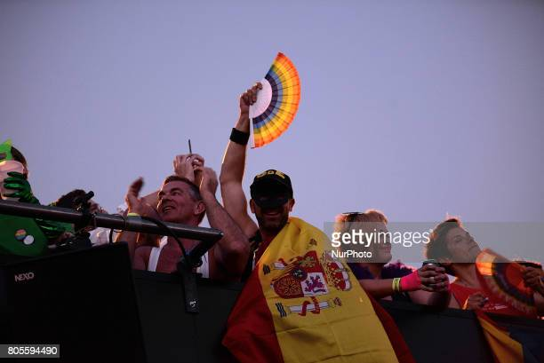 Participant whith a spanish flag on a open truck during the Gay Pride demonstration and parade in Madrid on July 1st 2017