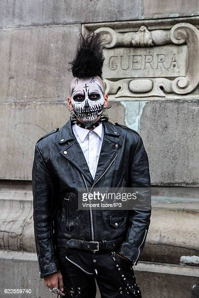 A participant who wears a skeleton makeup poses during the 'Catrinas Parade' a joyful annual event celebrated at the Day of the Dead on October 23...