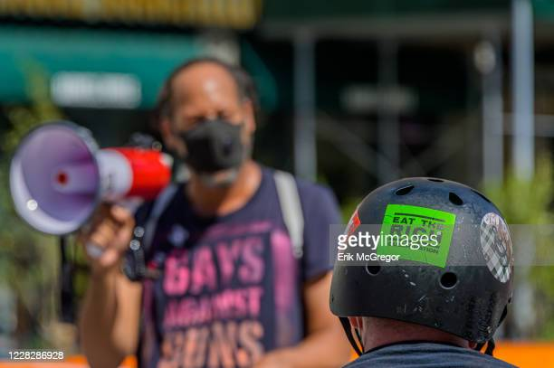 Participant with an Eat The Rich sticker on his helmet seen at the protest. Gays Against Guns , the direct action, gun violence prevention group...