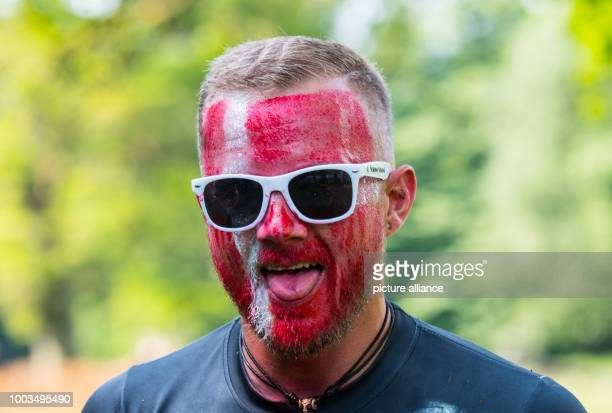 Aparticipant with his face coloured as the Danish flag shows his tongue in Waechtersbach Germany 3 June 2017 The 'Strong Viking Run' is an obstacle...