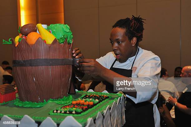 A participant works on a cake during the DC Central Kitchen's Capital Food Fight event at Ronald Reagan Building on November 11 2014 in Washington DC