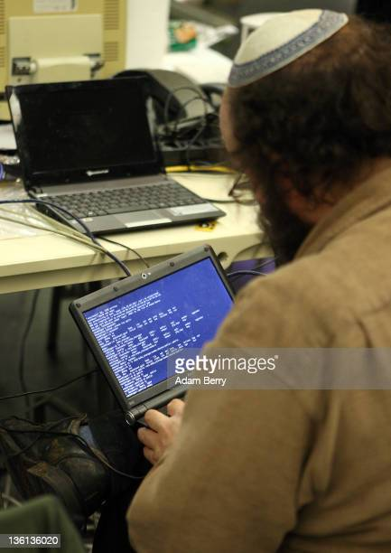 A participant works on a laptop on the first day of the 28th Chaos Communication Congress Behind Enemy Lines computer hacker conference on December...