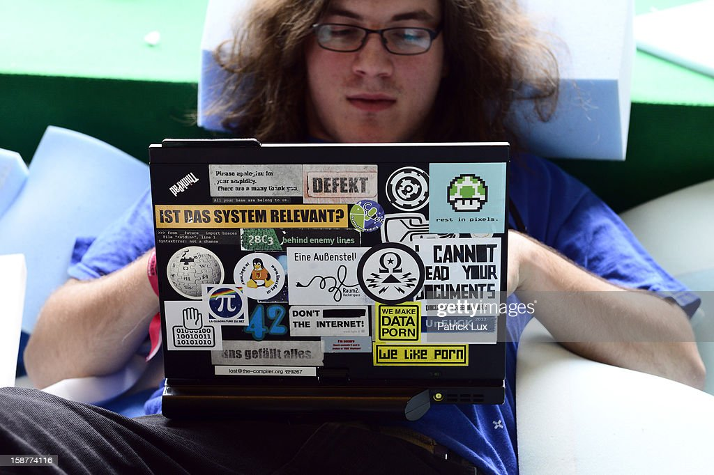 A participant works on his laptop in a foam pit at the annual Chaos Computer Club (CCC) computer hackers' congress, called 29C3, on December 28, 2012 in Hamburg, Germany. The 29th Chaos Communication Congress (29C3) attracts hundreds of participants worldwide annually to engage in workshops and lectures discussing the role of technology in society and its future.
