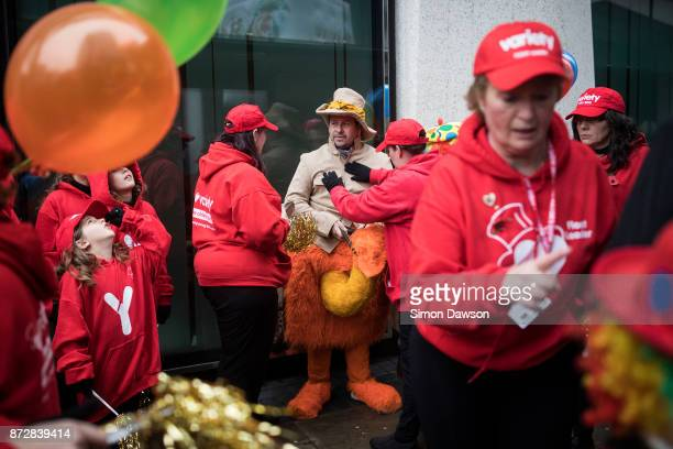 Participants adjust a performers costume before marching in the Lord Mayor's Show on November 11 2017 in London England The Lord Mayor's Show now in...