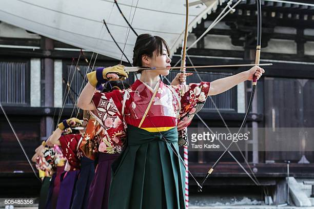 Participants aim at a target 60 meters away during an archery event for 20yearolds to celebrate their comingofage at Sanjusangendo Temple on January...