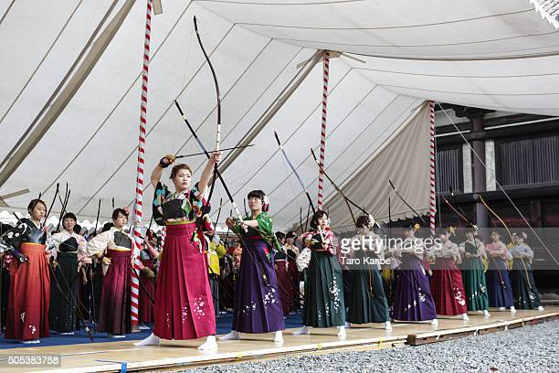 Participants aim at a target 60 meters away during in an archery event for 20yearolds to celebrate their comingofage at Sanjusangendo Temple on...