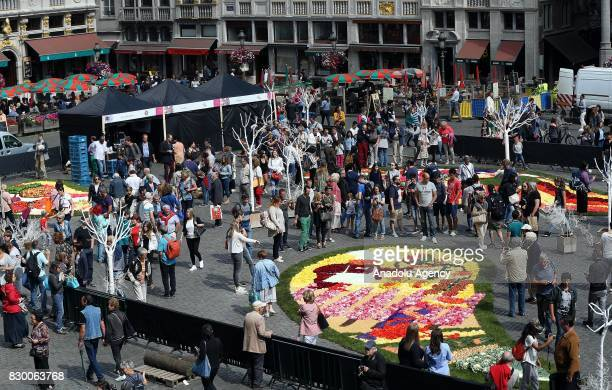 Participants and attendees form flower carpet by using flower leaves fruits and vegetables at Grand Place during Flowertime Festival in Brussels...