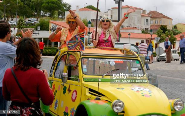 Participants and locals celebrate in Mafra the arrival of the the parade of Citroen classic cars 2CV during the World 2017 2CV Meeting July 30, 2017....