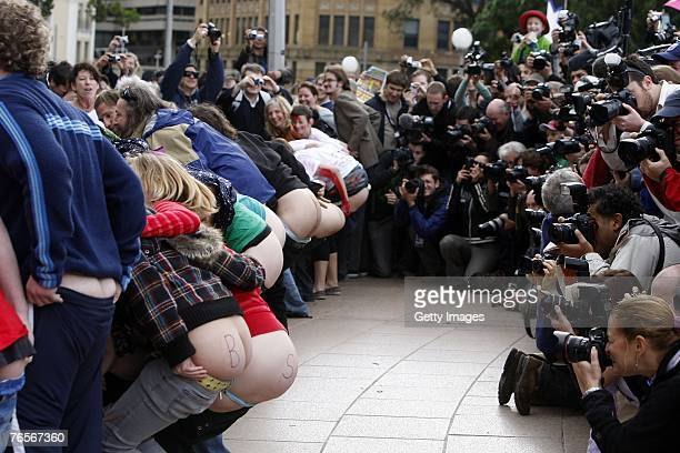 Participants and media at the Bums for Bush world record mooning attempt in Hyde Park on September 7 2007 in Sydney Australia George Bush is among...