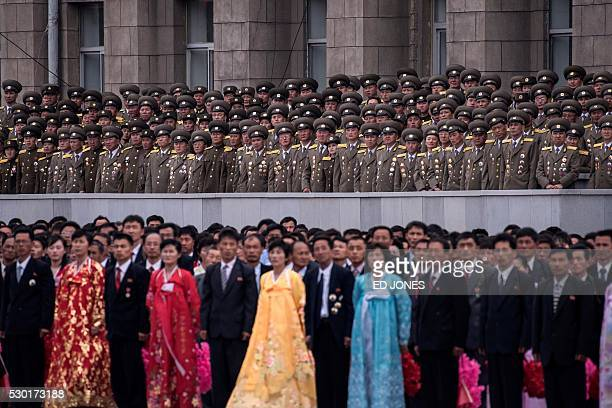 TOPSHOT Participants and military personnel look at North Korea's leader during a mass parade marking the end of the 7th Workers Party Congress in...
