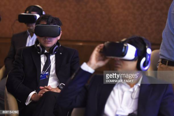 Participants and visitors test virtual reality headsets at the India Economic Summit hosted by the World Economic Forum in New Delhi on October 6...