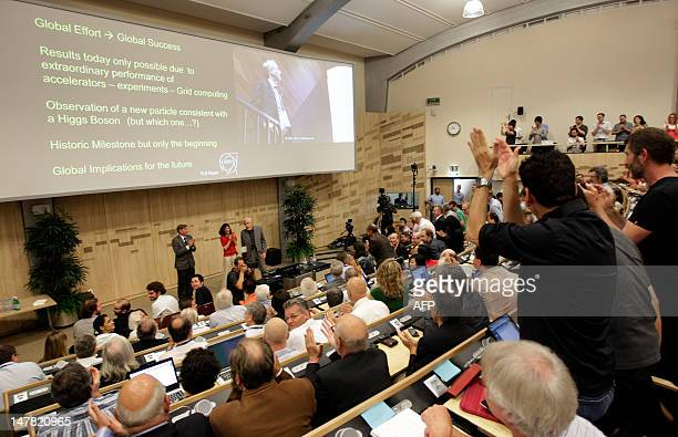 Participants applaud after the presentation of the ATLAS experiments results on July 4 2012 during a seminar on the latest update in the 50year bid...