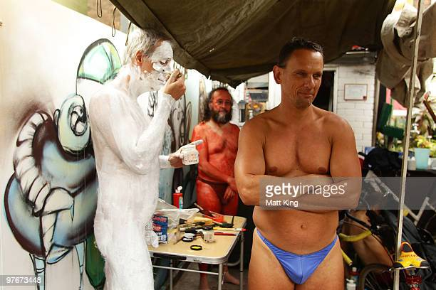 Participants apply body paint before riding during the annual World Naked Bike Ride Australia 2010 in central Sydney on March 13 2010 in Sydney...