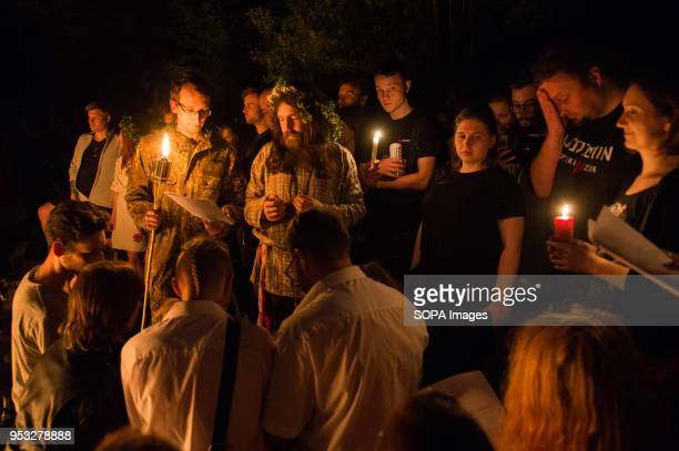 Participants are blessed by other participant during the Beltane feast of Fire next to Krakau Mound in Krakow The Beltane Fire Festival is an annual...
