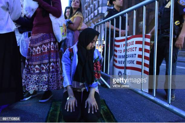Participants are praying in the Iftar at Trump Tower event of the M Power Change social organization and the New York State Immigrant Action Fund to...