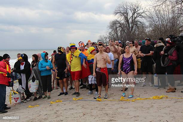 Participants are seen before they swim in a lake at temperatures around 18 centigrade degrees during the 30th annual Polar Bear Dip in the suburban...