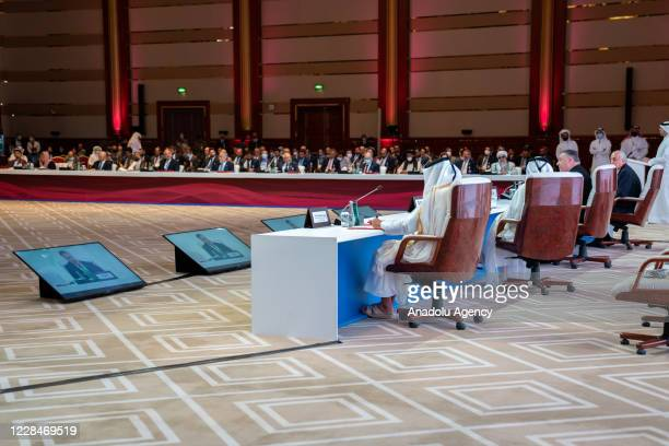 Participants are seen during intra-Afghan peace talks between the Afghan government and Taliban insurgents commenced in the Qatari capital Doha on...