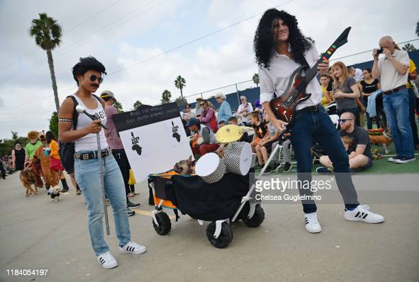 Participants are seen in Live Aid costumes at the Haute Dog Howl'oween Parade at Marina Vista Park on October 27 2019 in Long Beach California