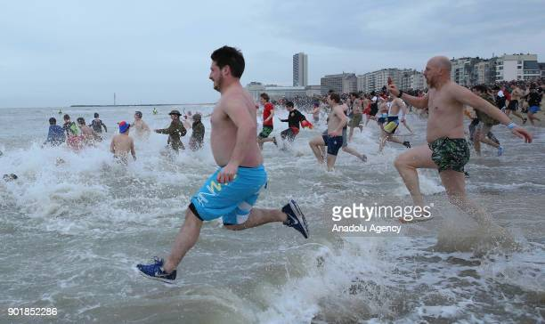 Participants are seen in the water during a polar bear plunge on a cold day in Oostende Belgium on January 06 2018 Approximately 5000 participants...