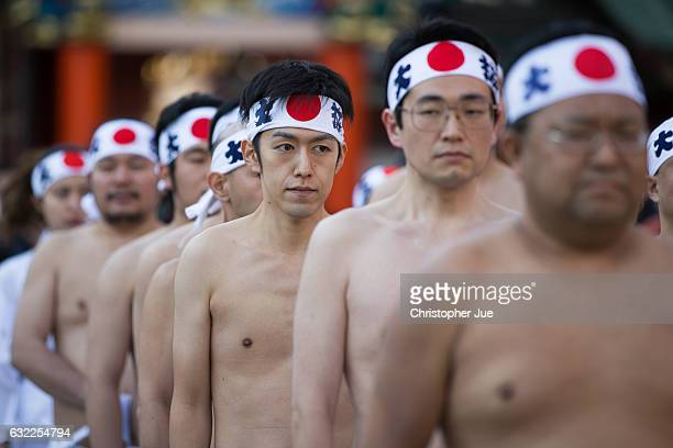 Participants are seen lined up prior to the start of the ice water winter purification ceremony on January 21 2017 in Tokyo Japan At Daikoku Matsuri...