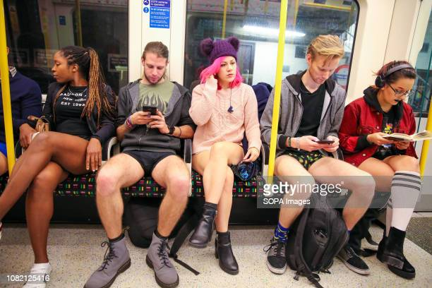 Participants are seen taking part during the 10th anniversary of 'No Trousers Tube Ride' event by travelling on the District Line on the London...