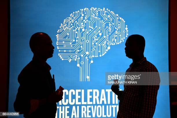 Participants at Intel's Artificial Intelligence Day stand in front of a poster during the event in the Indian city of Bangalore on April 4 2017 / AFP...