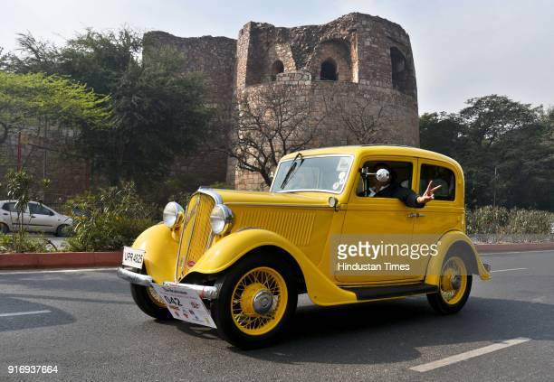 Participants at the 52nd edition of 'The Statesman Vintage and Classic Car Rally' passing through Connaught Place near the Statesmen Building on...