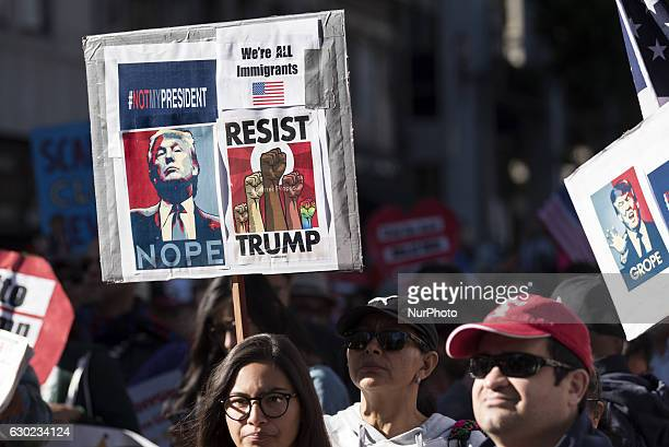 Participants at the International Migrants Day rally in Los Angeles California on December 18 2016 Many of the demonstrators voiced their displeasure...